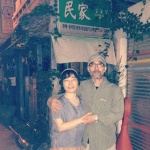 Mr. Kim and his wife outside their restaurant, Min Ga in Busan's PNU area