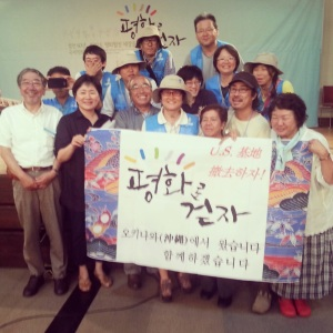 Activists from Osaka pose in solidarity with members of the International Peace March group