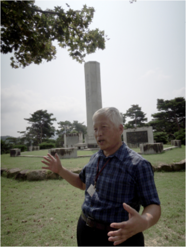 Our museum guide, the great-grandson of a peasant commander, retells the battle of Hwangtohyun
